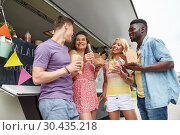 Купить «happy friends with drinks eating at food truck», фото № 30435218, снято 1 августа 2017 г. (c) Syda Productions / Фотобанк Лори