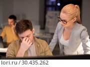 Купить «business team with computer working late at office», фото № 30435262, снято 26 ноября 2017 г. (c) Syda Productions / Фотобанк Лори