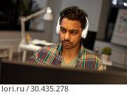 Купить «creative man with headphones working at office», фото № 30435278, снято 24 января 2018 г. (c) Syda Productions / Фотобанк Лори