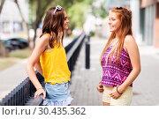 Купить «teenage girls or friends talking in summer city», фото № 30435362, снято 19 июля 2018 г. (c) Syda Productions / Фотобанк Лори