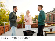 Купить «happy friends having bbq party on rooftop», фото № 30435402, снято 2 сентября 2018 г. (c) Syda Productions / Фотобанк Лори
