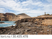 Купить «View on Capelinhos volcano and lighthouse on island Faial, Azores, Portugal», фото № 30435478, снято 4 мая 2012 г. (c) Юлия Бабкина / Фотобанк Лори