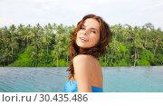 Купить «happy woman over infinity edge pool in sri lanka», фото № 30435486, снято 21 июля 2012 г. (c) Syda Productions / Фотобанк Лори