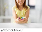 Купить «close up of girl holding chocolate easter eggs», фото № 30435594, снято 25 июля 2018 г. (c) Syda Productions / Фотобанк Лори