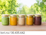 Купить «vegetable or fruit puree or baby food in jars», фото № 30435642, снято 21 февраля 2017 г. (c) Syda Productions / Фотобанк Лори