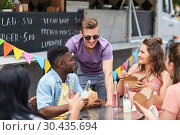 Купить «happy friends with drinks eating at food truck», фото № 30435694, снято 1 августа 2017 г. (c) Syda Productions / Фотобанк Лори
