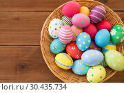 close up of colored easter eggs in basket. Стоковое фото, фотограф Syda Productions / Фотобанк Лори