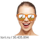 Купить «happy teen girl in sunglasses looking at giraffes», фото № 30435894, снято 24 июня 2019 г. (c) Syda Productions / Фотобанк Лори