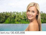 Купить «happy woman over infinity edge pool in sri lanka», фото № 30435898, снято 30 марта 2013 г. (c) Syda Productions / Фотобанк Лори