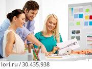 Купить «team of fashion designers working at office», фото № 30435938, снято 17 мая 2014 г. (c) Syda Productions / Фотобанк Лори