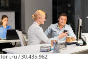 Купить «business people with smartphone at night office», фото № 30435962, снято 6 декабря 2017 г. (c) Syda Productions / Фотобанк Лори