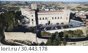 Купить «Aerial view of impressive medieval castle of Order of Calatrava on hill in town of Alcaniz, Spain», видеоролик № 30443178, снято 26 декабря 2018 г. (c) Яков Филимонов / Фотобанк Лори