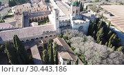 Купить «Aerial view of Monastery of Santa Maria de Santes Creus, Catalonia, Spain», видеоролик № 30443186, снято 14 февраля 2019 г. (c) Яков Филимонов / Фотобанк Лори