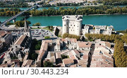 Купить «Aerial view of medieval fortified Chateau de Tarascon and Rhone river at sunny day», видеоролик № 30443234, снято 24 октября 2018 г. (c) Яков Филимонов / Фотобанк Лори
