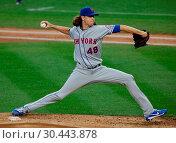 Купить «The New York Yankees take on the New York Mets during game 2 of the 2017 Subway Series at Yankee Stadium Featuring: Jacob DeGrom Where: Bronx, New York...», фото № 30443878, снято 15 августа 2017 г. (c) age Fotostock / Фотобанк Лори