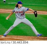 Купить «The New York Yankees take on the New York Mets during game 2 of the 2017 Subway Series at Yankee Stadium Featuring: Jacob DeGrom Where: Bronx, New York...», фото № 30443894, снято 15 августа 2017 г. (c) age Fotostock / Фотобанк Лори