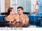Купить «Man and woman are enjoying of celebration their date», фото № 30447330, снято 18 июля 2017 г. (c) Яков Филимонов / Фотобанк Лори