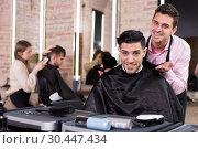 Hairdresser finished haircut of pleased man client. Стоковое фото, фотограф Яков Филимонов / Фотобанк Лори