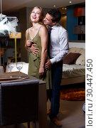Купить «Loving couple in apartment», фото № 30447450, снято 24 сентября 2018 г. (c) Яков Филимонов / Фотобанк Лори