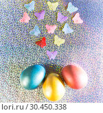 Купить «Easter background. Colored pearl eggs of gold, pink, coral, blue and turquoise on a halo background with a copy space», фото № 30450338, снято 31 марта 2019 г. (c) Светлана Евграфова / Фотобанк Лори