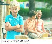 Portrait of boy 9-12 years old which is taking offense on his friends. Стоковое фото, фотограф Яков Филимонов / Фотобанк Лори