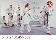 Купить «Girls training during karate class», фото № 30450658, снято 25 марта 2017 г. (c) Яков Филимонов / Фотобанк Лори