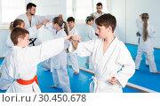 Купить «Boys training in pair», фото № 30450678, снято 25 марта 2017 г. (c) Яков Филимонов / Фотобанк Лори