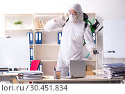 Купить «Professional contractor doing pest control at office», фото № 30451834, снято 16 ноября 2018 г. (c) Elnur / Фотобанк Лори
