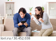 Купить «Young couple in budget planning concept», фото № 30452038, снято 22 января 2019 г. (c) Elnur / Фотобанк Лори