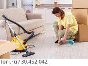 Купить «Middle-aged woman cleaning new apartment», фото № 30452042, снято 27 декабря 2018 г. (c) Elnur / Фотобанк Лори