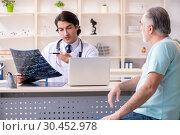 Купить «Old man visiting young male doctor», фото № 30452978, снято 9 января 2019 г. (c) Elnur / Фотобанк Лори