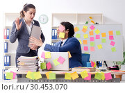 Купить «Two colleagues employees working in the office», фото № 30453070, снято 22 января 2019 г. (c) Elnur / Фотобанк Лори