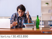 Купить «Male teacher drinking in the classroom», фото № 30453890, снято 21 декабря 2018 г. (c) Elnur / Фотобанк Лори