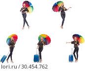 Купить «Woman with suitcase and umbrella isolated on white», фото № 30454762, снято 20 июня 2019 г. (c) Elnur / Фотобанк Лори