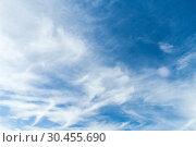 Купить «Blue sky with white cirrus clouds at day», фото № 30455690, снято 30 октября 2018 г. (c) EugeneSergeev / Фотобанк Лори