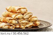 Купить «Горка блинов с начинкой на тарелке», эксклюзивное фото № 30456562, снято 24 февраля 2017 г. (c) Dmitry29 / Фотобанк Лори