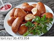 Купить «bread dough turnovers with ground chicken meat», фото № 30473954, снято 21 марта 2019 г. (c) Oksana Zh / Фотобанк Лори