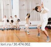 Купить «Two fencing instructors showing effective techniques», фото № 30474002, снято 30 мая 2018 г. (c) Яков Филимонов / Фотобанк Лори