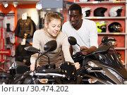 Купить «couple in motorcycle shop choosing new vehicle», фото № 30474202, снято 16 января 2019 г. (c) Яков Филимонов / Фотобанк Лори