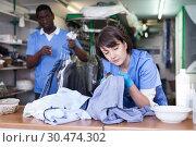 Купить «Woman working in dry cleaner», фото № 30474302, снято 15 января 2019 г. (c) Яков Филимонов / Фотобанк Лори