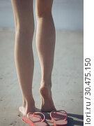 Купить «Woman standing with tiptoe on sand at beach », фото № 30475150, снято 14 ноября 2018 г. (c) Wavebreak Media / Фотобанк Лори