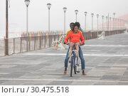 Купить «Couple enjoying at bicycle while riding at pavement», фото № 30475518, снято 14 ноября 2018 г. (c) Wavebreak Media / Фотобанк Лори