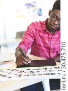 Купить «Graphic designer working on graphic tablet at desk », фото № 30475710, снято 18 ноября 2018 г. (c) Wavebreak Media / Фотобанк Лори
