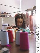Купить «Female fashion designer working with sewing machine», фото № 30475734, снято 18 ноября 2018 г. (c) Wavebreak Media / Фотобанк Лори
