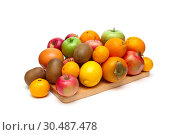 Купить «Ripe fruits on white background», фото № 30487478, снято 18 ноября 2011 г. (c) Ласточкин Евгений / Фотобанк Лори