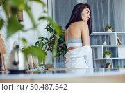 Купить «Attractive brunette woman in the kitchen.», фото № 30487542, снято 18 марта 2019 г. (c) Женя Канашкин / Фотобанк Лори