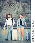 Купить «Attractive couple going the historic city center», фото № 30487694, снято 25 мая 2017 г. (c) Яков Филимонов / Фотобанк Лори