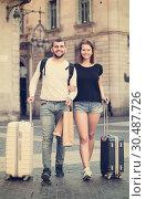 Купить «Couple going the historic city center», фото № 30487726, снято 25 мая 2017 г. (c) Яков Филимонов / Фотобанк Лори
