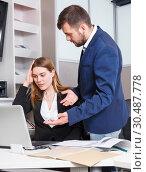 Купить «Manager scolding frustrated salesgirl», фото № 30487778, снято 9 апреля 2018 г. (c) Яков Филимонов / Фотобанк Лори