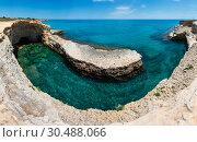 Grotta del Canale, Sant'Andrea, Salento sea coast, Italy. Стоковое фото, фотограф Юрий Брыкайло / Фотобанк Лори
